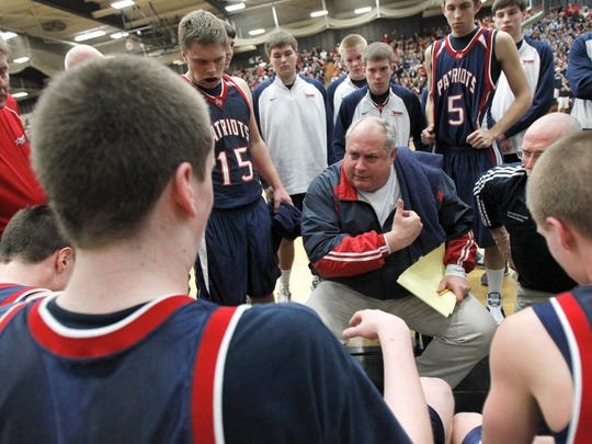 Appleton East High School coach John Mielke talks to players during a time out against Germantown during the WIAA Division 1 super sectional basketball game Tuesday, March 15, 2011, at the Kolf Sports Center in Oshkosh, Wisconsin.