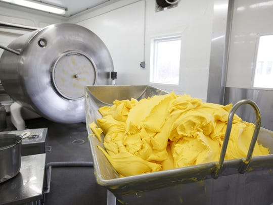 Freshly made butter sits in a holding vat before being