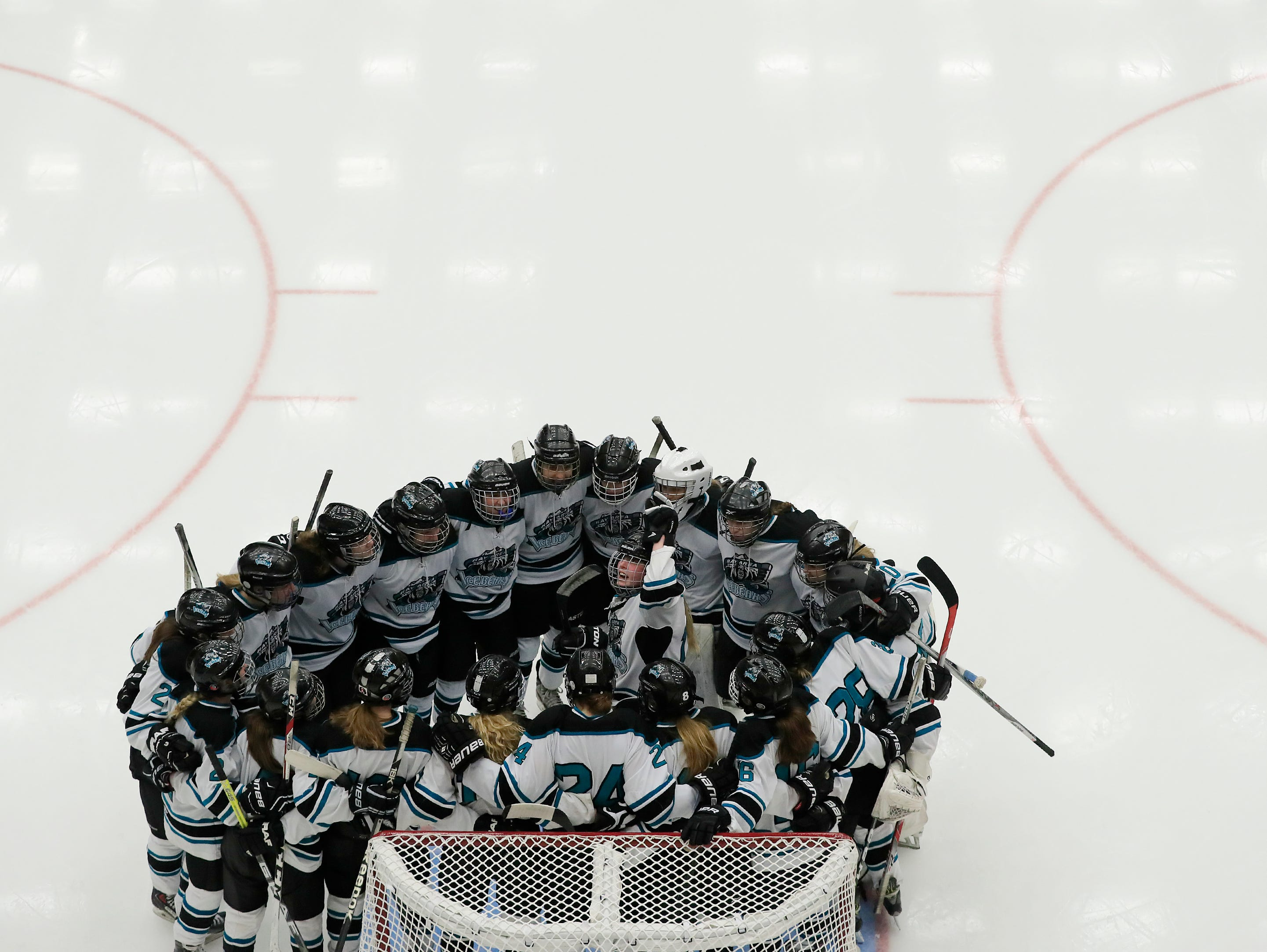 Bay Area Ice Bears forward Janelle Wotruba (13) pumps up her team before the championship match at the 2017 State Hockey Tournament at Veterans Memorial Coliseum on Saturday, March 4, 2017, in Madison, Wis. The Storm won the match 2-1 in overtime. Adam Wesley/USA TODAY NETWORK-Wisconsin