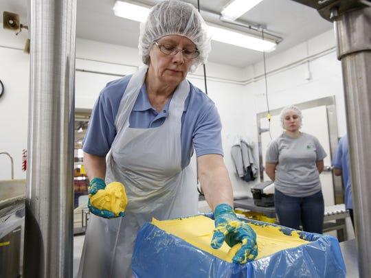 Joan Reindl, a 32-year Pine River employee, packs freshly