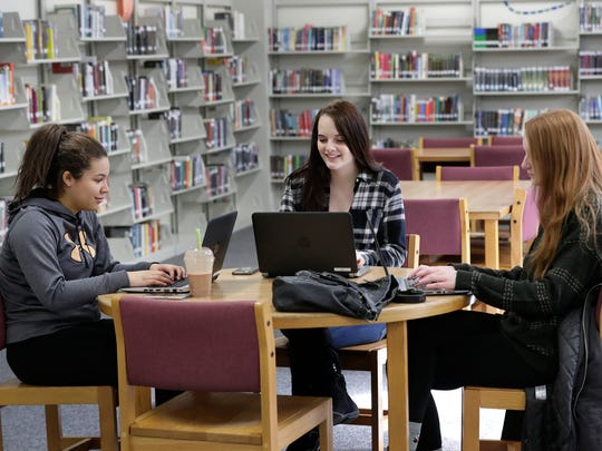 Caitin French, left, Savanna Bumpus and Courtney Schaffer, right, study together Tuesday, March 14, 2017, in the Library Media Center at Little Chute High School.  If the $17.8 million facilities referendum is approved, the Library Media Center would be part of a new two-story addition to the building, and the current LMC would be converted to classrooms.