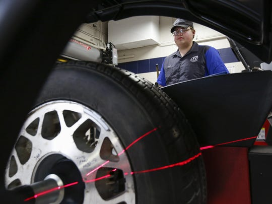 Lakeshore Technical College student Kyle Williquette watches as the new tire balancer scans a wheel at the Advanced Automotive Technology Center March 29 in Cleveland.