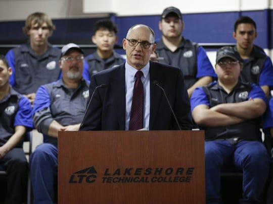 Lakeshore Technical College President Mike Lanser makes remarks on the new Advanced Automotive Technology Center with a group of LTC students behind him March 29 in Cleveland.