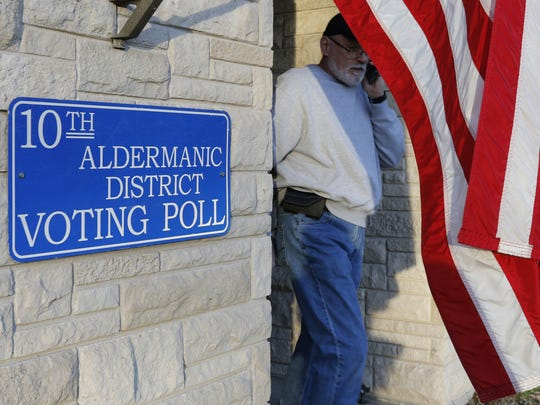 A man leaves the polls on election day Tuesday in Manitowoc.