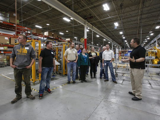 Orion Energy Systems' Kelly Reif, right, leads the Chamber Young Professionals group on a tour of their facility during Young Professionals Week in Manitowoc in 2017. Josh Clark/USA TODAY NETWORK-Wisconsin