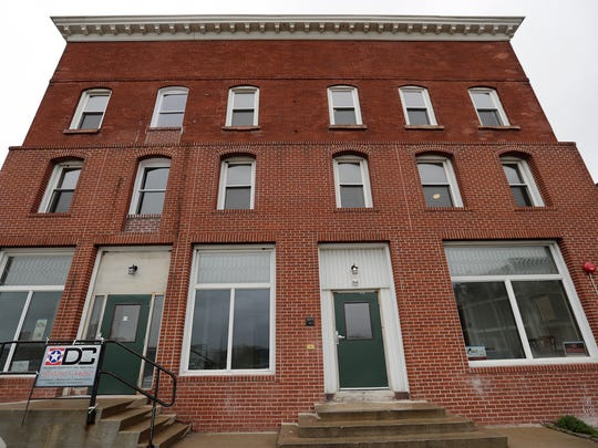 The Hibernia House, built at 409 N. Broadway in 1875, has been renovated. The renovation adds 20 micro apartments to a residential and business redevelopment area on North Broadway.