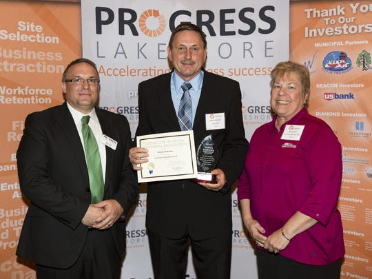 From left, Peter Wills, Dennis Dedering and Bonnie Timm pose for a picture after Dedering won Progress Lakeshore's Economic Accelerator Award during the sixth annual Excellence in Economic Development Awards May 3 in Manitowoc.