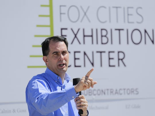 Gov. Scott Walker talks during a press conference Friday at the construction site of the new Fox Cities Exhibition Center in downtown Appleton.