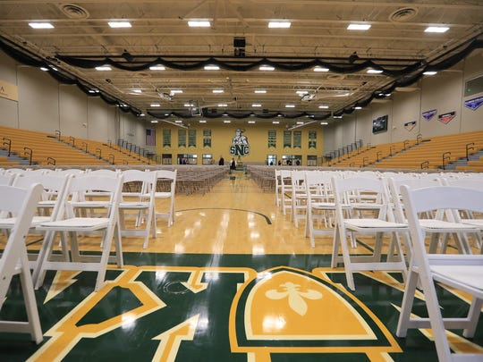 The new gymnasium in the Mulva Family Fitness and Sports Center at St. Norbert College is set up for the college's spring graduation ceremony on Sunday.