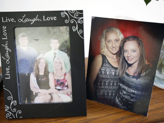 Pictures of Dianna Wallen's children on her bookshelf in her house in Manitowoc.