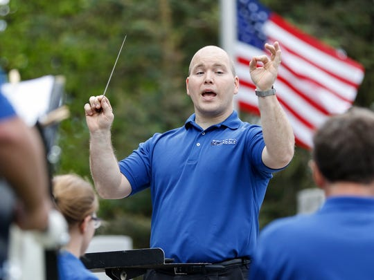 File - Jeremiah Eis directs the Manitowoc Marine Band during the Memorial Day ceremony at Manitowoc's Veterans Memorial May 29, 2017, in Manitowoc.