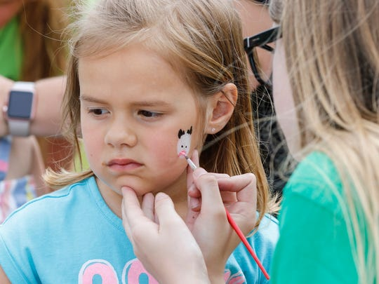 Isabella Daul, 4, of De Pere sits patiently as she gets a cow painted on her face at the Manitowoc County Breakfast on the Farm hosted by Habeck Homestead Farms Sunday, Jun. 11, 2017, in Maribel, Wis. Josh Clark/USA TODAY NETWORK-Wisconsin