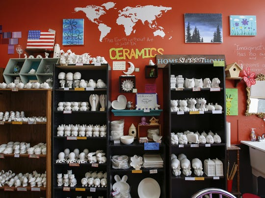 A brightly decorated wall serves as the backdrop for the many items you can purchase and paint at Glaze & Paint Saturday, Jun. 24, 2017, in Manitowoc, Wis. Josh Clark/USA TODAY NETWORK-Wisconsin