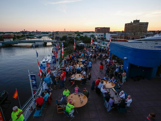 The sun sets over Subfest in downtown Manitowoc, Wis.,