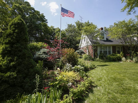A plethora of plants surround the American flag in