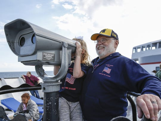 Richard Hewer of Big Rapids, Mich., shows his granddaughter