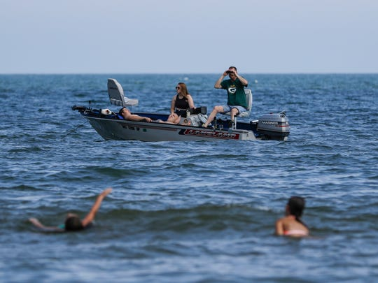 Some opted to view the action from Lake Michigan during