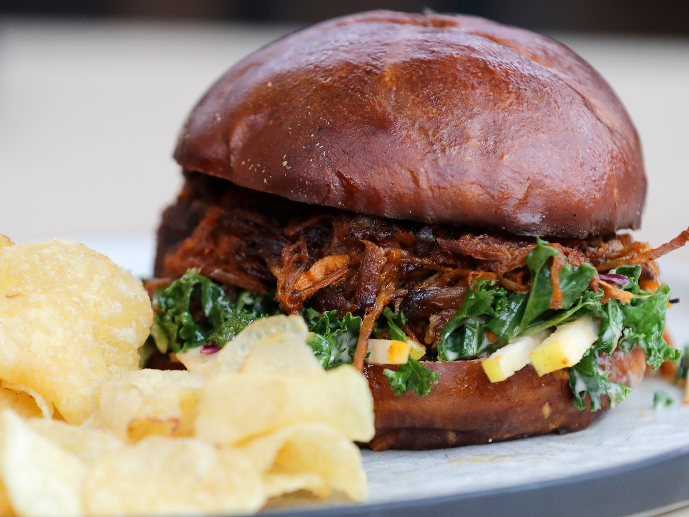 The BBQ pulled pork sandwich is shown at Hinterland