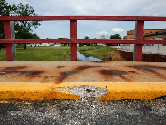 The 4th St. bridge is in need of repairs July 25, 2017, in Reedsville, Wis. The Manitowoc County Finance Committee is mulling a 0.5 percent sales tax and may use the revenue to fund road maintenance.