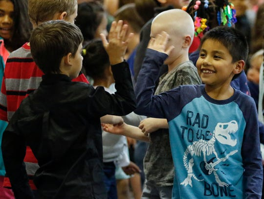 Jefferson Elementary students high five and wish eachother