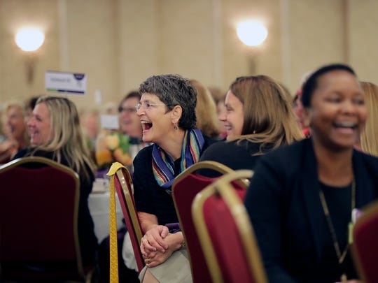 Attendees enjoy a light moment during Dr. Ann McKee's