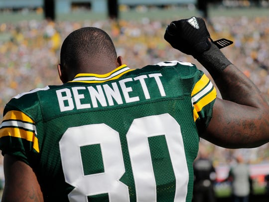 Green Bay Packers' Martellus Bennett raises his arm and looks up during the National Anthem Sunday, September 10, 2017, at Lambeau Field in Green Bay, Wis. 