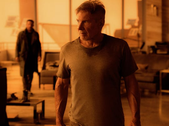 Ryan Gosling and Harrison Ford appear in a scene from