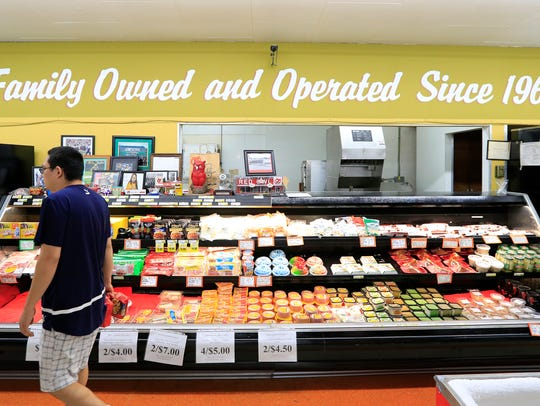 Customers browse the Mason Brothers' Red Owl supermarket
