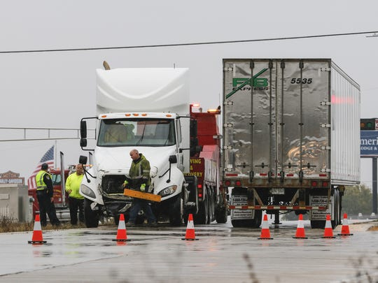Semi truck on Interstate 43 southbound exit ramp at Calumet Avenue Thursday, Nov. 2, in Manitowoc.