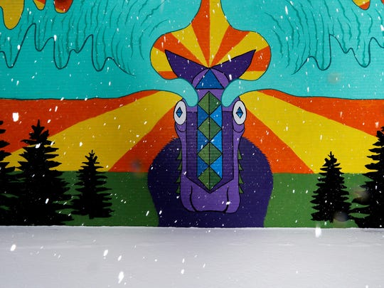Snow falls by the Morty the Moose mural painted by