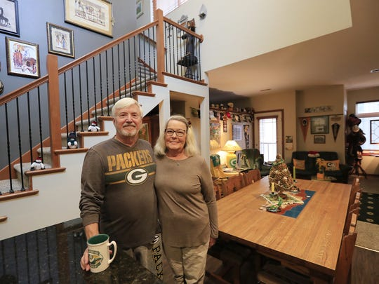 Jim and Norma Jorgensen in the dining room of their CityDeck Landing apartment. The Jorgensens moved to downtown Green Bay apartment from a house in Allouez earlier this year.