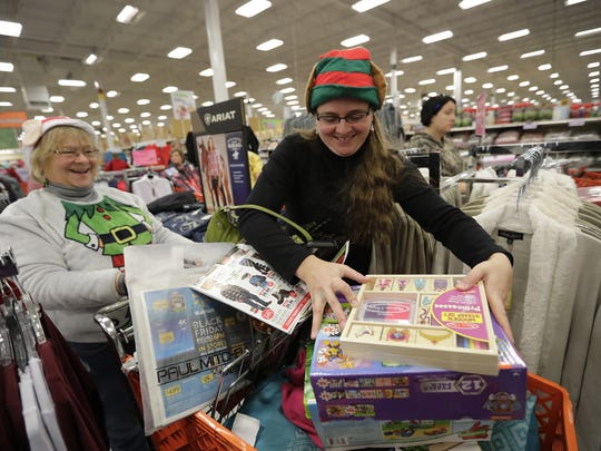 Chris Stache, left, of Hilbert and her daughter, Melissa Mrotek of Green Bay, have fun shopping for toys at Mills Fleet Farm on Friday in Grand Chute.