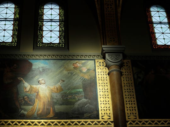 Recently renovated oil paintings in the sanctuary are shown at St. Francis Xavier Cathedral on Friday, December 1, 2017 in Green Bay, Wis. The cathedral, which has been closed for renovations for the past 3 months, reopens on Sunday for 9 a.m. mass. 