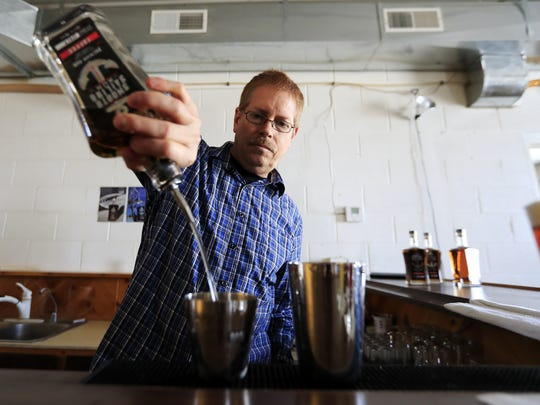 Curt Naegeli, owner of North Woods Distillery, makes a drink with his Smooth Sailing toffee-flavored rum on Wednesday, November 29, 2017 in Coleman, Wis. Adam Wesley/USA TODAY NETWORK-Wisconsin
