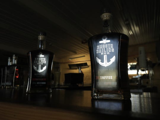 Bottles of Smooth Sailing toffee-flavored rum are shown at North Woods Distillery on Wednesday, November 29, 2017 in Coleman, Wis. Adam Wesley/USA TODAY NETWORK-Wisconsin