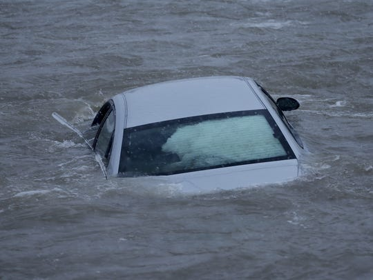 A car swerved off the road and landed in Lake Michigan