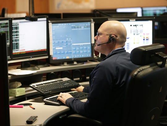 Telecommunicator Scott Aldrich handles non-emergency