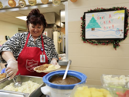 Barb Boniface serves the New Years lunch for those in need at the Salvation Army on Friday, December 29, 2017 in Green Bay, Wis. Adam Wesley/USA TODAY NETWORK-Wisconsin