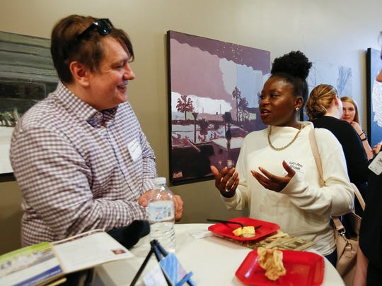 David Harris and Lucy-Ann Muabe socialize during the Young Professionals of Manitowoc County Sip, Sample and Socialize event at the Artist's Lofts Wednesday, Apr. 26, 2017, in Manitowoc.