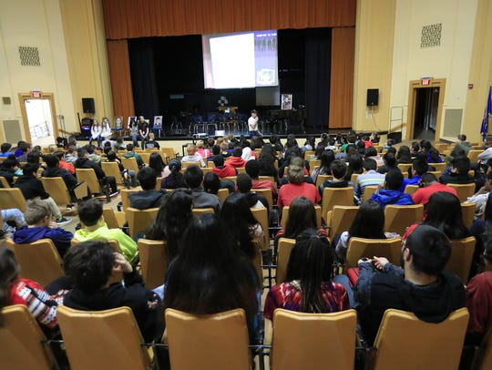 Eighth graders listen to an anti-bullying presentation