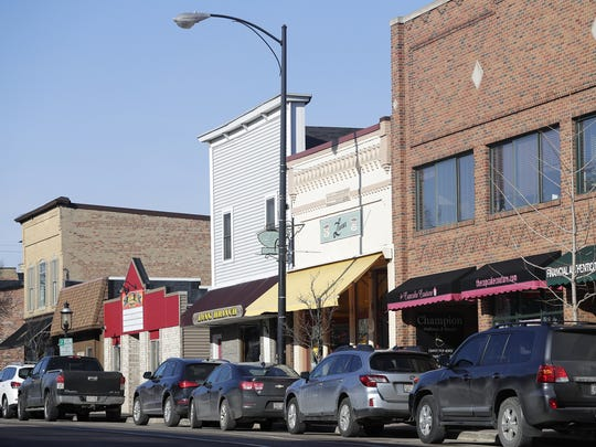 Downtown businesses along Main Avenue in De Pere on Friday.