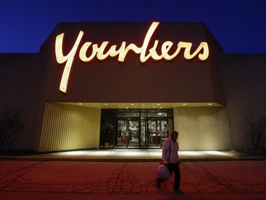 File - A woman leaves the Manitowoc Younkers at 700