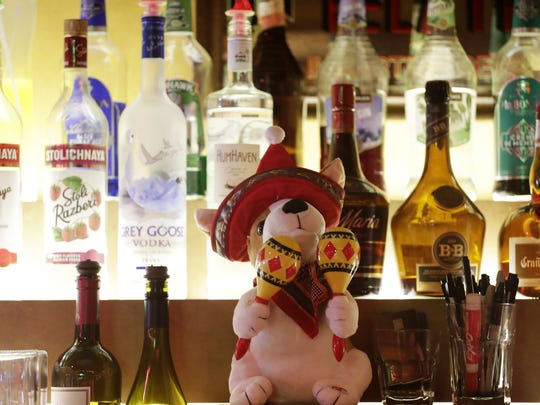 A stuffed dog is shown behind the bar at Los Banditos