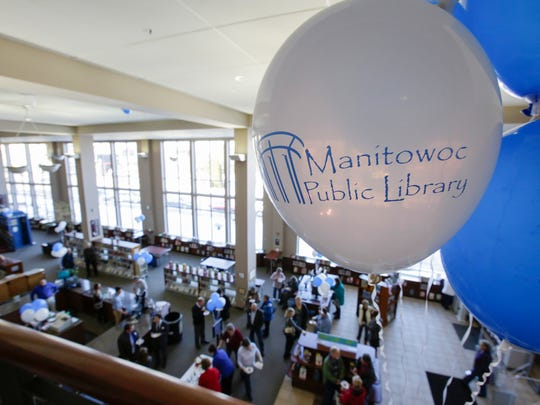 FILE - Balloons decorate the balcony at Manitowoc Public Library in February 2018.