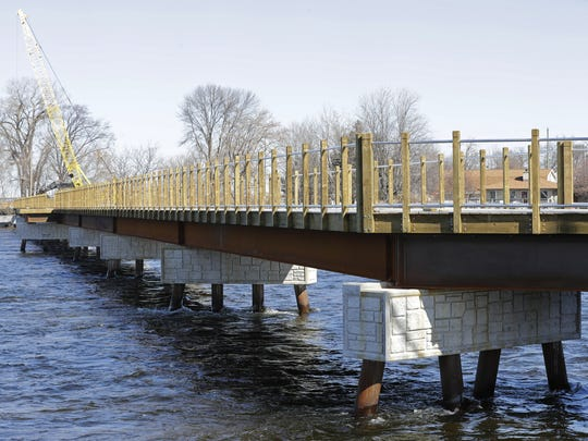 A bridge over the north branch of the Fox River in Menasha will be part of a 5K trail loop around the southern half of Little Lake Butte des Morts. A companion bridge crosses the south branch of the river in Neenah.
