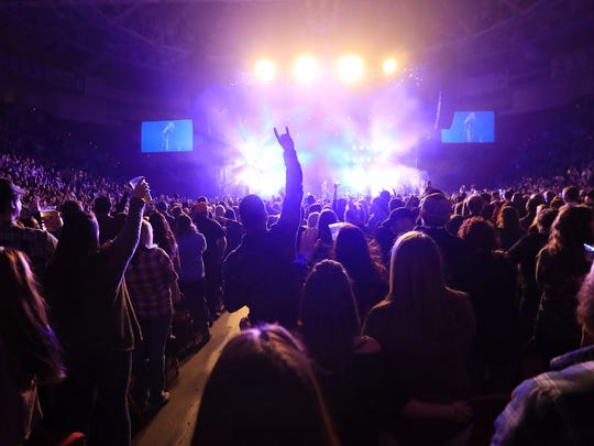 Fans cheer as Chris Young performs at the Resch Center