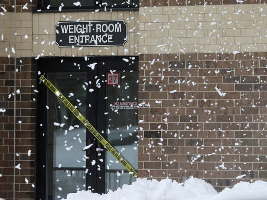 Police tape warns against entering the weight room and gym at De Pere High School. The district temporarily closed the gyms at the high school and at Foxview Intermediate School after they noticed the roofs were sagging under the weight of about 2 feet of snow that fell over the weekend.