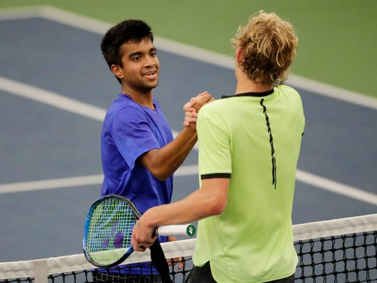Oshkosh West's Neel Raut shakes hands with De Pere's Nathan Balthazor after Raut won their Division 1 semifinal at the WIAA boys tennis state tournament Saturday at Nielsen Tennis Stadium in Madison.