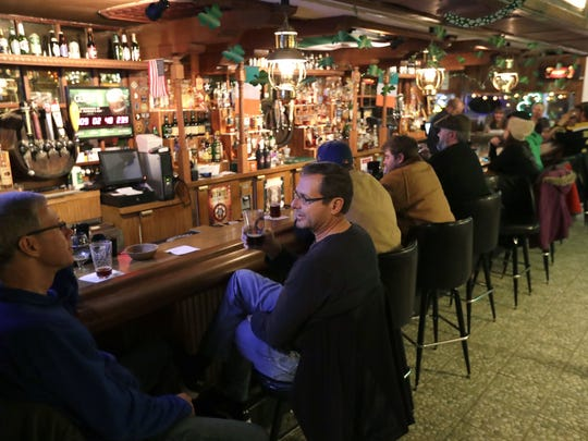 Patrons enjoy some drinks and each other's company at McGuinness Irish Pub in Appleton.