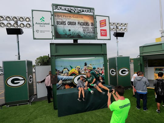"Fans do a Lambeau leap at the Green Bay Packers unveiling of Lambeau Field Live, a traveling '100 years of football"" exhibit, outside Lambeau Field on Tuesday, June 12, 2018 in Green Bay, Wis. 